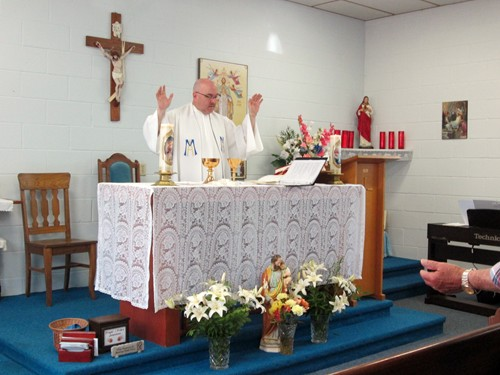 Pere Oulette, O.M.T.Director of the National Marian Shrine,  celebrates Mass.